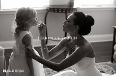 Jessi, an Orlando area bride, applies some finishing touches of lipstick to her flower girl. For more of Robert McClory's work, visit http://silverimageweddings.robertmcclory.com CONTACT Carla Hotvedt at SILVER IMAGE® Photo Agency and Weddings 352.373-5771 or carla@silverimageweddings.com....