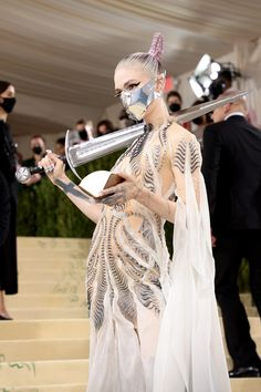 Met Gala 2021: The Meaning Behind Grimes's Sword | Vogue Claire Boucher, Iris Van Herpen, Pigtail Braids, Look Plus, Anna Wintour, Celebrity Look, Red Carpet Fashion, Call Her, Bodice