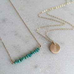 The perfect summer accessories! Gold Pineapple Necklace + Turquoise Bar Necklace www.nellenetree.com