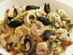 Ina Garten Italian Seafood Salad from FoodNetwork.com.... forget the salad... the dressing looked amazing! ... EVOO, garlic, tomatoes, oregano, lemon...