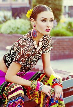 Spanish and Mexican inspired fashion photo shoot, colorful, bright, mixed patterns, floral headbands, flowers in hair. Photo by Hannah Lux Davis