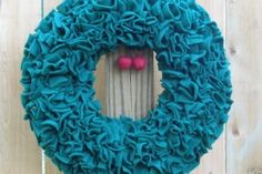 Cut out rounds pinned onto a foam wreath