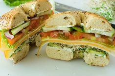 Veggie & Cheese Bagel. Main ingredients: bagel, cream cheese, tomatoes, cucumbers, avocado, muenster cheese, cheddar cheese, lettuce.