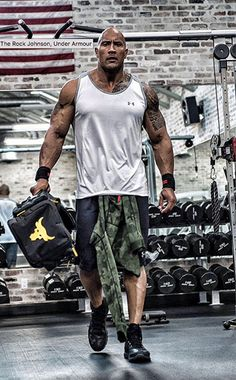 The Rock Arms while lifting weights in Under Armour Gear.