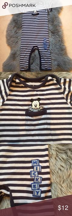 Disney Baby Mickey Onesie Disney Baby Mickey Navy and light blue striped onesie. Can be worn as a play suit or PJs. Purchased in Disney World. EUC. Soft Cotton Stretch. Snap closure. Disney Shirts & Tops