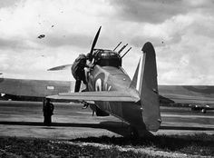 """british-eevee: """"A gunner climbs into the turret of a Boulton Paul Defiant """" Ww2 Aircraft, Military Aircraft, Ww2 Planes, Vintage Airplanes, Battle Of Britain, Royal Air Force, World War Two, Wwii, Climbing"""