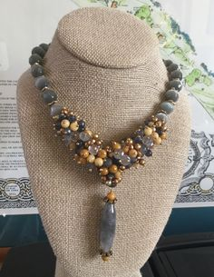 Carmondi Necklace Cats Eye, Jasper, Pearls and Quartz. Retail $360.00 To order email theresa@luliiblu.com