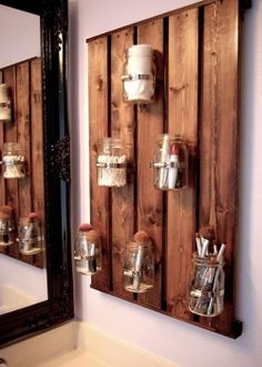 Mason jar wall storage for all the little things cluttering my counter
