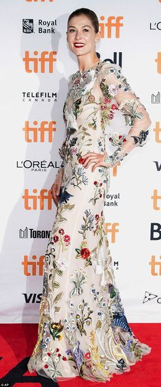 Gorgeous: Rosamund Pike dazzled on the red carpet at the Toronto International Film Festival on Monday night in a floral-themed gown
