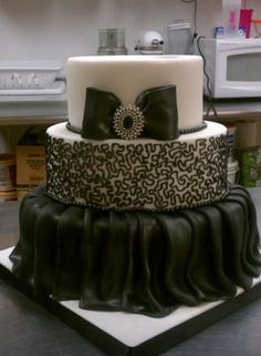 Black and white wedding cake! Created by Tito's Cakes