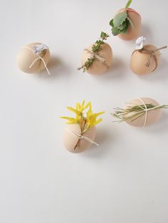 Im so doing this for easter placecards this year!    flowers and twine