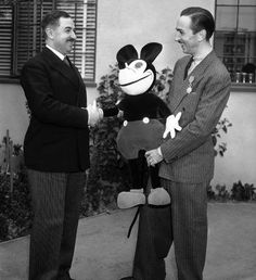 Today In History: January 8:     1936: Legion of Honor is conferred upon Walt Disney  -   The Legion of Honor is conferred upon Walt Disney, right, creator of Mickey Mouse, in a ceremony in Hollywood.