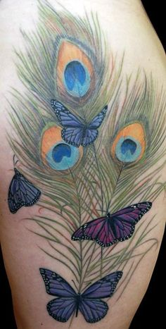 great peacock feathers tattoo with butterflies