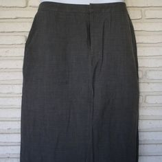 Grey work skirt Gap high waisted work skirt. Pockets in front and slit in back. Comfy and classy! GAP Skirts