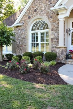 Yard Progress, mulching beds, dark mulch, knockout roses, curb appeal, landscaping, stacked rock front, stucco, planked shutters, Devonshire green