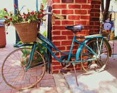 ARTIST:  Donna Wilson  A lovely old bicycle from the past for sale in downtown McKinney,Texas.