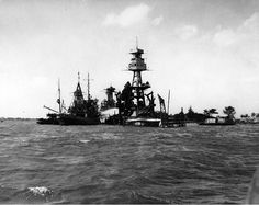USS Arizona, two days after the attack.  USS Navajo & USS Tern continue to spray water on the smoldering wreck.  December 9, 1941.