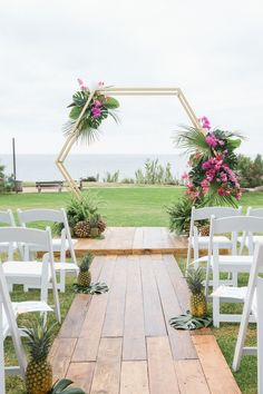 tropical geometric ceremony arch with pineapple decor | Photography: Taylor Abeel Photography