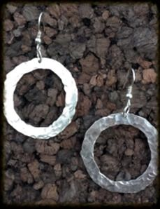 Hammered Circle Earrings   Perfect for dressing up that perfect outfit. These 40 mm hammered argentium silver circle earrings are 2½ inches long.    $50.00