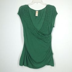 Anthropologie green cross over top size medium Green jersey knit cross over front top. Braid detail on front. Very clean, no holes. Anthropologie Tops Tees - Short Sleeve