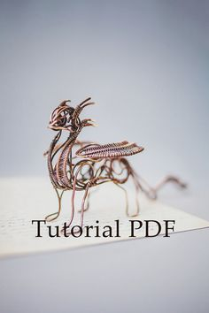 Tutorial about the wire copper sculpture Dragon with soldering in English. All steps have been described in great detail, 130 pictures. PDF tutorial, 63 pages (I sell only pdf file without materials).  This is for advanced users only. Because work is very complicated, it will take 8-10 hours. I explained the little things, like how to make a ball on the end or solder copper. But I told exactly how to make a sculpture of the animal.  Tools and Supplies: Chain nose pliers Round nose pliers…