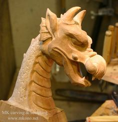 Dragon head is ready to be attached to the Viking ship now. via MK Carving - www.mkono.net