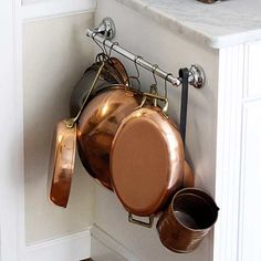 Cut kitchen clutter once and for all with these super simple and totally genius solutions for storing pots and pans.