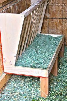 Homestead Revival: Feeders and Water for Goats. This would reduce so much waste! I really want to add this to my goat feeder. Goat Hay Feeder, Horse Feeder, Goat Playground, Goat Shed, Goat Shelter, Goat House, Goat Care, Boer Goats, Nigerian Dwarf Goats