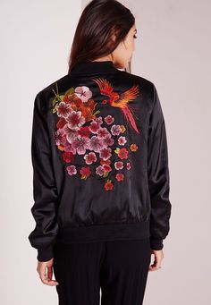 Look fierce in this Black oriental print bomber jacket this season. In a chic silky fabric this lightweight beaut with silver zipper fasten and pockets to the front make this jacket a must-have. The oriental embroidery on the back of this b...