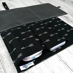 This beautifully designed nappy change set // nappy wallet // nappy clutch // travel change mat features a built-in change mat and has 3 practical pockets to fit 2-3 nappies, travel baby wipes (hard case or small soft pack), disposable nappy bags, mini nappy rash cream etc. One pocket