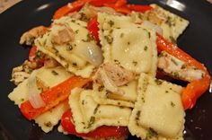 Cheese ravioli with pesto, red peppers, and grilled chicken.