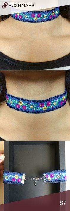 Blue floral Embroidered Choker Blue floral Embroidered Choker Has extension chains as seen in the back :) worn only a couple of times ! Jewelry Necklaces