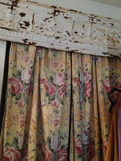 I think a rustic tin cornice board might be the answer to my window treatment challenge in my living room. I'll have to check out the restoration store near us.
