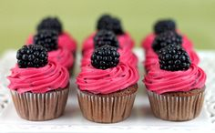 Chocolate cupcakes with blackberry buttercream.