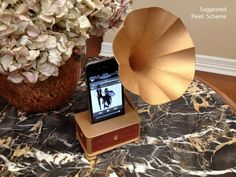 This is a sound magnifier for your iPhone, based on the old Gramophones of the late 19th and early 20th Centuries. The sound horn, which is a separate piece, is adjustable up and down.