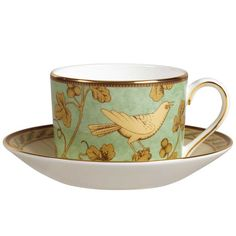 Classy teacup and saucer with a bird design. I like the color scheme.