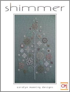 CM Designs Shimmer - Cross Stitch Pattern. Model stitched on 14 Ct. Country French Rain Aida using DMC floss with Kreinik #4 Braid and Blending Filament. Stitch
