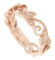 Crafted of 14K red gold, this antique style wedding band depicts a diamond studded vine motif. The ring measures 5.2mm in width. Size: 6 1/2. We can re-size and reorder.