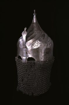 Helmet with Neck Guard of Mail and Nose Guard Iranian (?) (Artist) Turkish (?) (Artist) PERIOD 16th century (early Safavid) MEDIUM steel with inlaid silver (Arms & Armor) ACCESSION NUMBER 51.75 MEASUREMENTS 20 1/16 x 9 3/16 x 8 15/16 in. (51 x 23.4 x 22.7 cm) GEOGRAPHIES northwest Iran (Place of Origin)