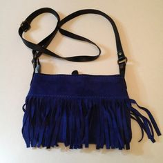 Suede fringe cross body bag Blue suede bag, almost never used! Cute on the shoulder or cross body. Great with white jeans. Bags Crossbody Bags