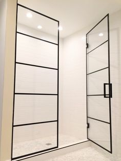 Beautiful black framed shower enclosures with French doors by Ultimate Glass Art, Inc. Custom design We specialize in black framed glass shower doors and glass shower enclosures and black shower hardware in Chicago. Contact Ultimate Glass for custom glass shower designs, www.ultimateglassart.com