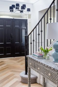A Classic Contemporary Transformation of a 1990's Home Duck Egg Blue Tiles, Penny Round Tiles, Cool Color Palette, Blue Curtains, Grand Entrance, Iron Wall, Herringbone Pattern, Modern Farmhouse, Home And Family