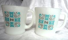Vintage Fire King white milk glass mugs with atomic Blue Heaven pattern. Turquoise-aqua blue and gray abstract geometric design with d-handles. Anchor Hocking. At AngelGrace on etsy.