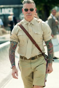 I'm in love with the grey hair, tats and military style in general, so this gentleman, Nick Wooster, is pretty much perfection.