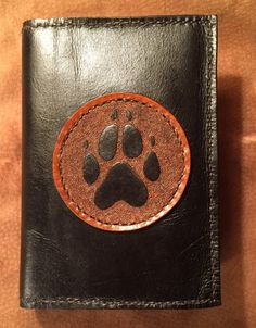 Black sketchbook/journal/diary cover with tooled black wolf/dog paw print on brown - refillable