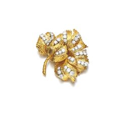 DIAMOND BROOCH, VAN CLEEF & ARPELS, 1970S Designed as a flower, the textured petals accented with brilliant-cut diamonds, signed Van Cleef & Arpels, numbered, French assay and maker's marks, case stamped Van Cleef & Arpels.