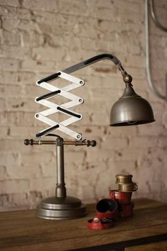"""Industrial Vertical Scissor Table Lamp 18""""t - 32""""t Please be aware that some products are handmade and unique therefore there may be slight variations in each i"""