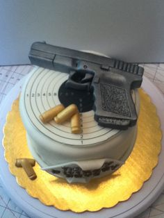 www.facebook.com/nikkiscreativeconfections glock cake target bullets edible