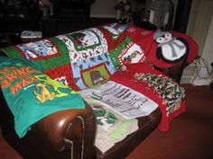 My collection of t shirts and jumpers along with my grinch throw