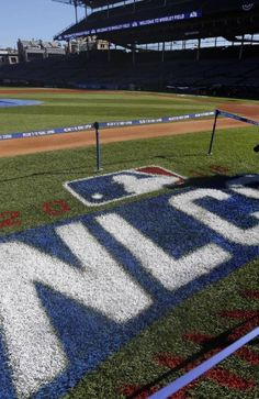 A grounds crew prepare the field for baseball's National League Championship Series at Wrigley Field, Friday, Oct. 14, 2016, in Chicago.